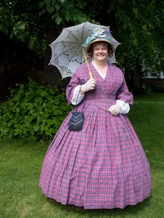 A lady wearing a 1860s dress