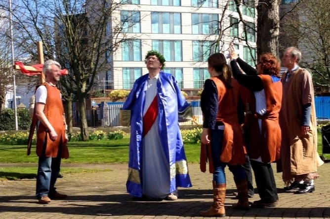 A man dressed as Jesus in a purple robe and with a crown of thorns during a walk of witness