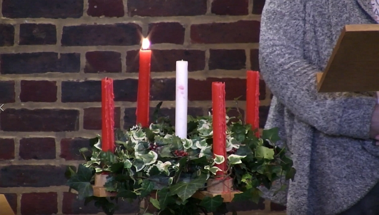 The Advent wreath at church with one candle lit