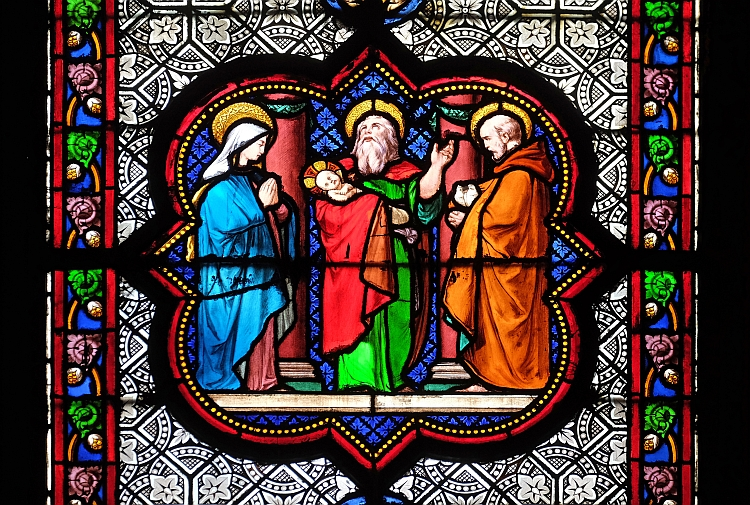 A stained glass window depicting Jesus being presented in the temple