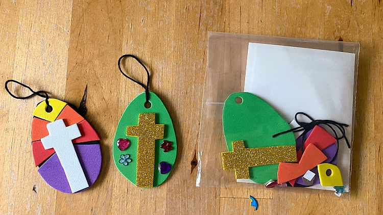 Two Easter egg decorations made from foam shapes and a craft kit containing the craft items needed to make them