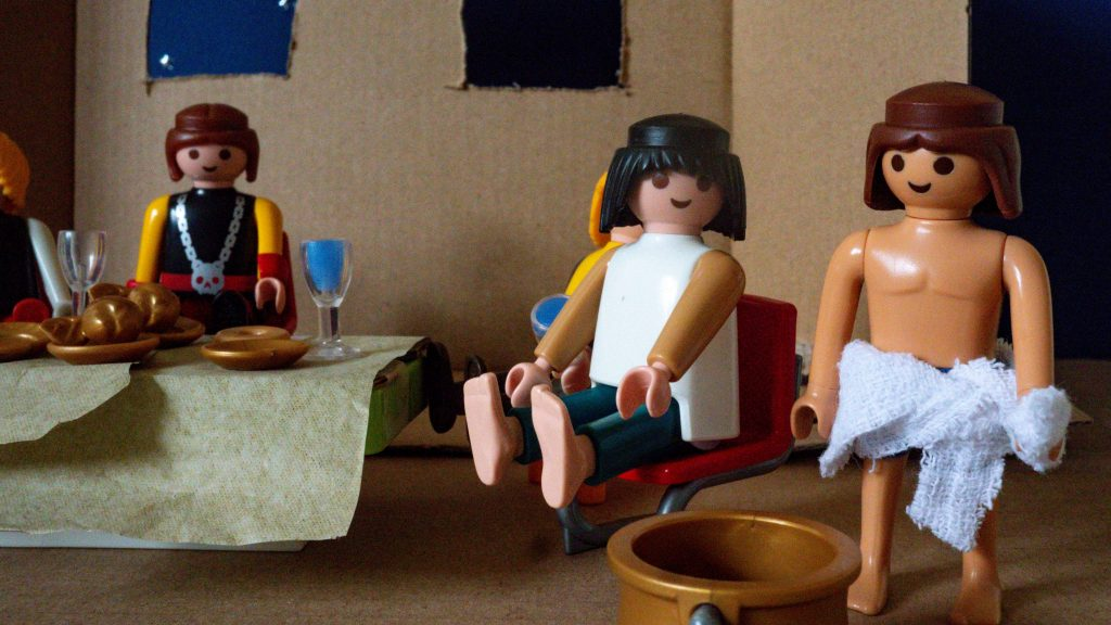 A Playmobil scene showing Jesus washing his disciples' feet