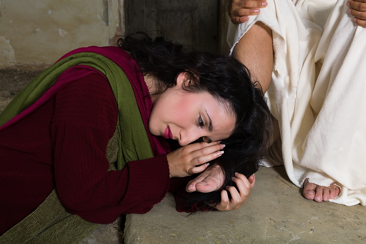 A woman with her hair wrapped around a man's foot