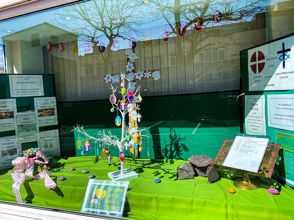 Our Easter window for 2021, showing our Easter tree and white flower cross of remembrance