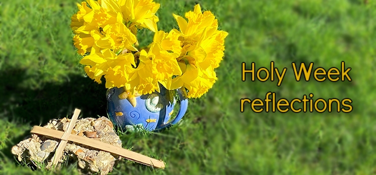"A cross on a stone in front of a vase of daffodils and the words ""Holy Week reflections"""