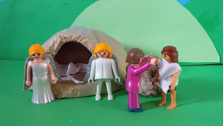 A Playmobil scene depicting Mary Magdalene recognising the risen Jesus outside the tomb