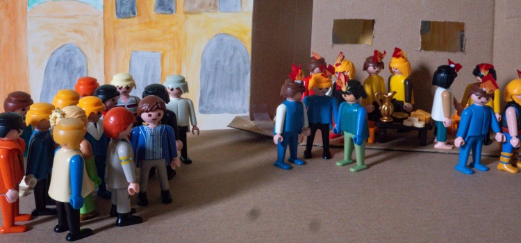 A Playmobil scene depicting the disciples with tongues of fire on their heads and a crowd gathering at Pentecost
