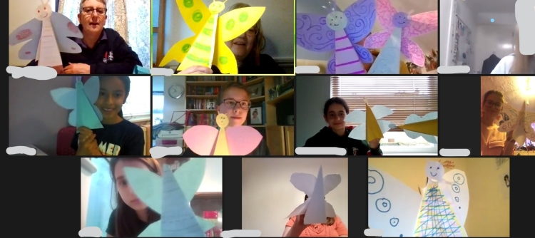 GB members holding up handmade butterflies during a Zoom meeting