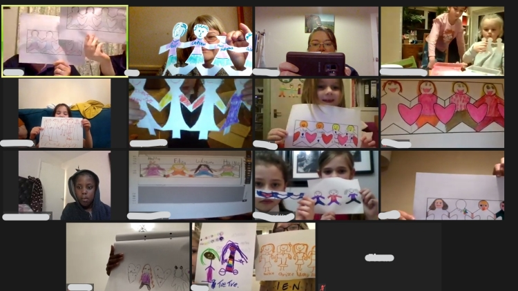GB members holding up paper dolls made during a Zoom meeting
