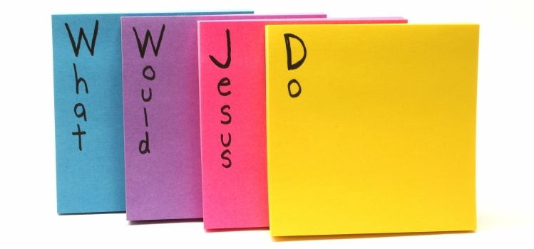 The words 'What Would Jesus Do' written on post-it notes