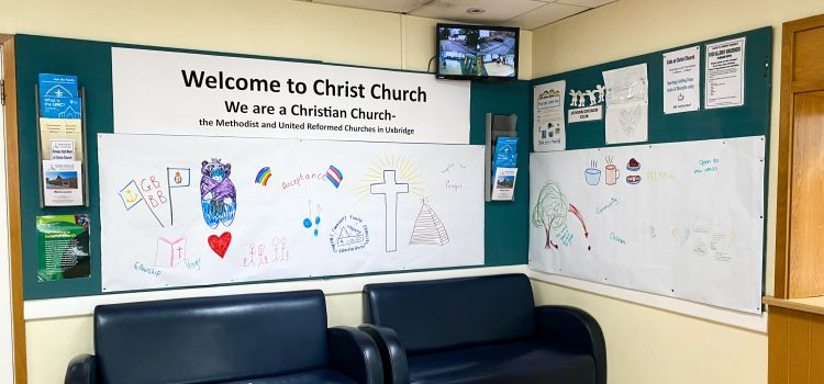 The meeting area of Christ Church with a banner on the walls showing drawings of the church and words such as 'love' and 'acceptance'